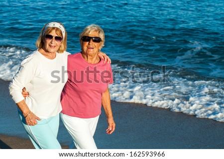 Portrait of two senior female friends in casual sportswear outdoors. - stock photo