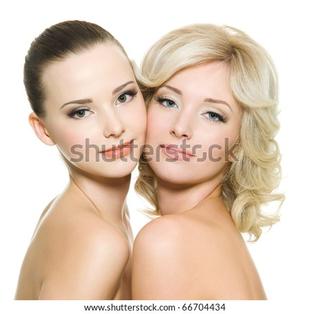 Portrait of two sensuality women standing together over white background - stock photo