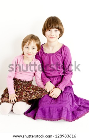 portrait of two sisters - stock photo