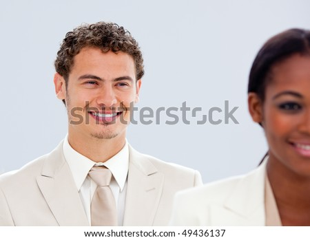 Portrait of two smiling business people in a company - stock photo