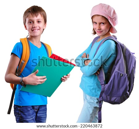 Portrait of two smiling pupils of grade school with backpacks and books posing. Isolated over white background. Education childhood concept - stock photo