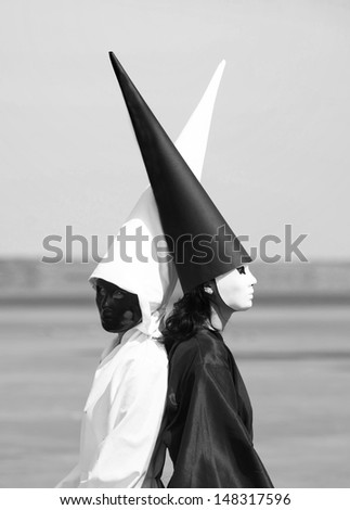 Portrait of two strange people in black and white clothes. Artwork