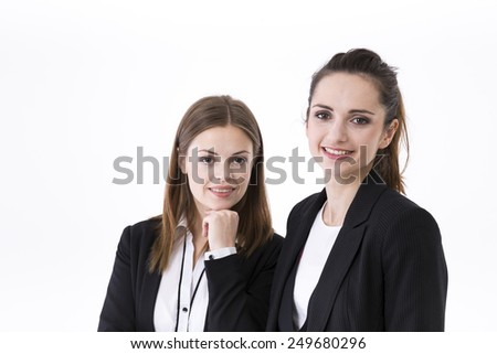 Portrait of two stylish Businesswomen. Isolated on white background. Caucasian brunette female model. - stock photo