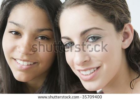 Portrait of two teenage girls smiling - stock photo