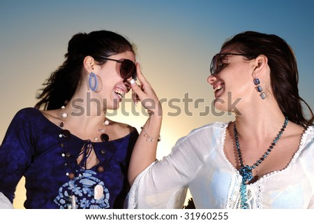 Portrait of two trendy young women having fun - stock photo