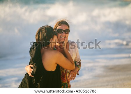 Portrait of two woman at the beach - stock photo