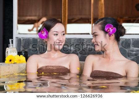 Portrait of two women having spa procedures - stock photo