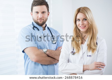 Portrait of two young attractive physicians - stock photo