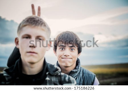 portrait of two young funny teenagers outdoor - stock photo