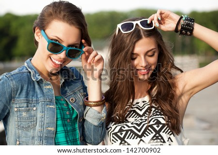 Portrait of two young girls having fun. Outdoors, lifestyle - stock photo