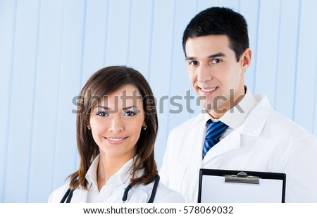 Portrait of two young medical people at office. Healthcare, lab and medicine.