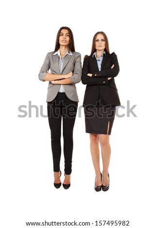 Portrait of two young successful businesswomen isolated on white background - stock photo