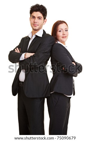 Portrait of two young trainees with arms crossed - stock photo
