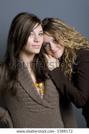 Portrait of two young women close together - stock photo