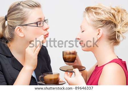Portrait of two young women enjoying delicious cup of coffee. - stock photo