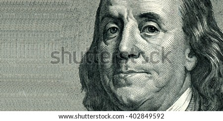Portrait of U.S. statesman, inventor, and diplomat Benjamin Franklin as he looks on one hundred dollar bill obverse. The portrait is expanded from the right side - stock photo