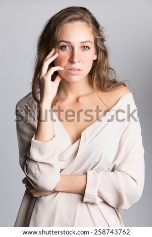 Portrait of unhappy desperate young woman - stock photo