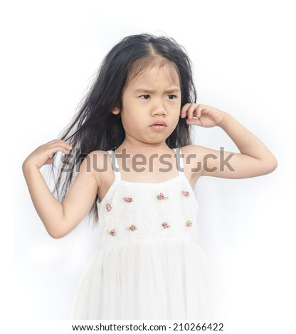 Portrait of  unhappy little girl  on a white background. - stock photo