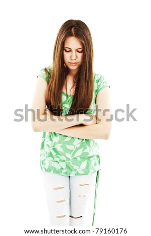 Portrait of unhappy teenage girl isolated on white