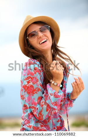 Portrait of uoung and happy woman on the beach - stock photo