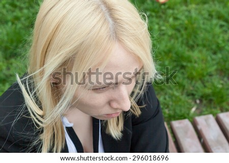Portrait of upset and nervous young blonde