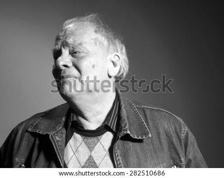 Portrait of upset elderly man - stock photo