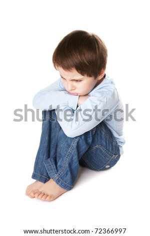 Portrait of upset little boy isolated on white background - stock photo