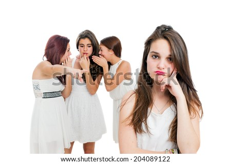 Portrait of upset teen girl with girls in background laughing.Isolated on white background.   - stock photo
