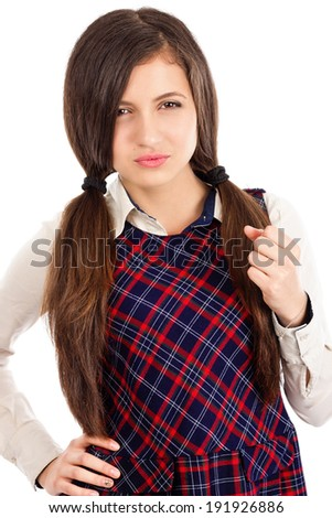 Portrait of upset teenager showing her fist isolated over white background - stock photo