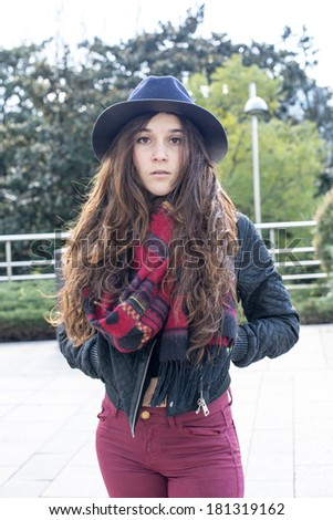 Portrait of urban stylish woman with hat and scarf, outdoor.