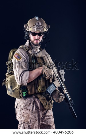 Portrait of US Army Soldier on Dark Background - stock photo