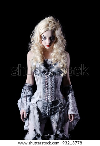 portrait of vampire woman with stage makeup isolated on black - stock photo