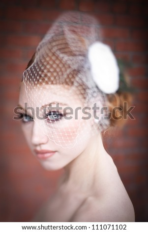 Portrait of veiled bride with red hair. - stock photo