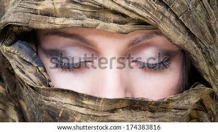 Portrait of veiled woman with closed eyes. - stock photo