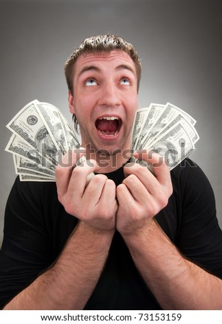Portrait of very excited man with money - stock photo