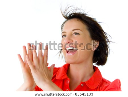 portrait of very happy girl clapping hands - stock photo