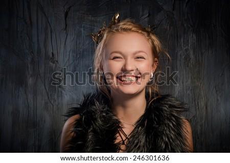 Portrait of very happy woman. On dark background - stock photo