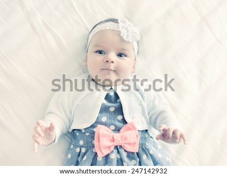 Portrait of very sweet little baby girl. Instagram like filter. - stock photo