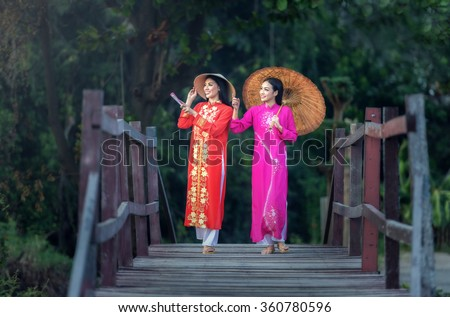 Portrait of Vietnamese girl traditional dress, Ao dai is famous traditional costume for woman in Vietnam - stock photo