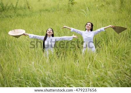 Portrait of vietnamese women Freedom to good feeling on the grass field