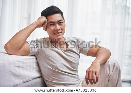 Portrait of Vietnamese young handsome man looking at camera