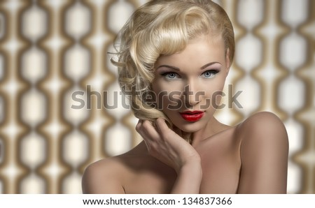 portrait of vintage woman with retro make-up and hair-style, looks in camera and posing as a diva on 70 background - stock photo