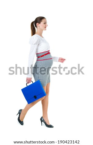 Portrait of walking pregnant businesswoman with document case, isolated on white background