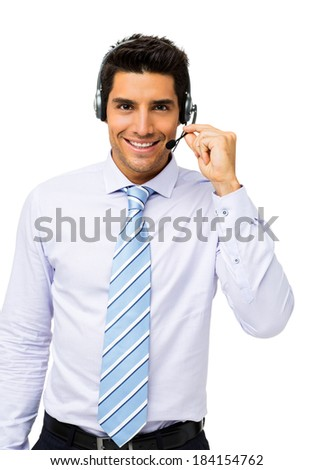 Portrait of well-dressed call center representative talking on headset over white background. Vertical shot. - stock photo