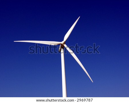 portrait of wind turbine in blue sky