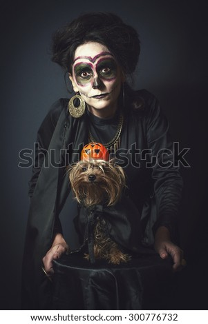 Portrait of woman and dog in disguise for Halloween - stock photo