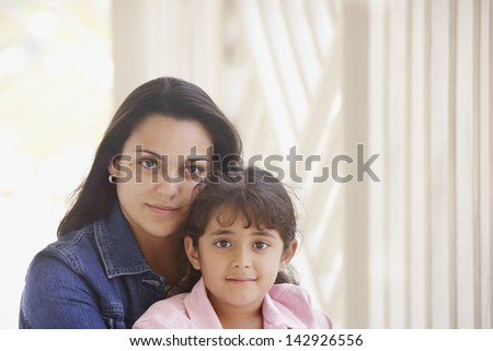 Portrait of woman and girl - stock photo