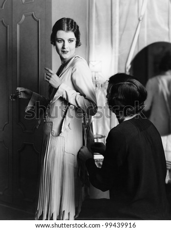 Portrait of woman being helped with dressing - stock photo