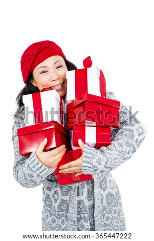 Portrait of woman carrying gifts against white background