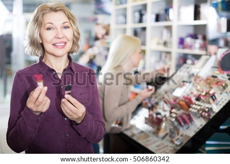 Portrait of woman doing shopping in beauty store